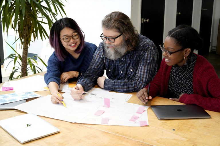 picture of three designers collaborating